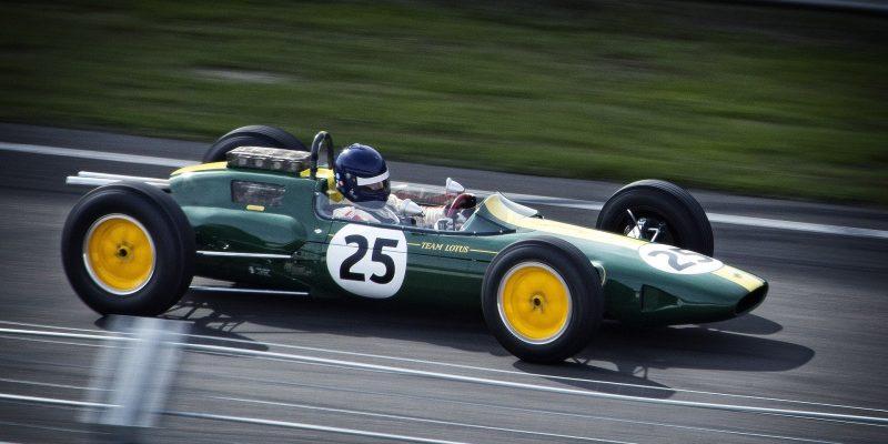 a racing car racing by like Lady Godiva